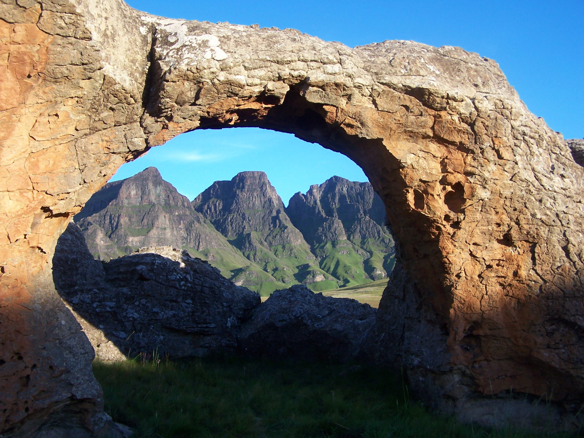 Three Bushmen and Rock Arch
